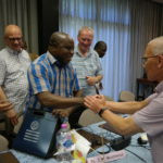 Former Vicar General Bro. Jos Mathijssen congratulates Bro. Jean-Marie Mukonkole, the new Vicar General